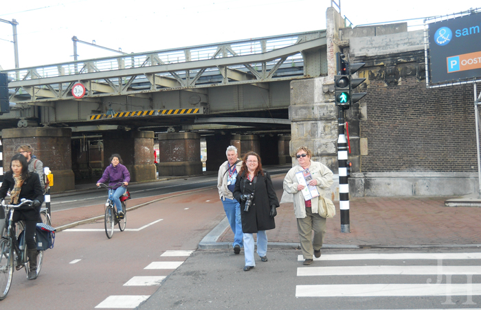 Crossing the street, trying to stay out of the bike path in Amsterdam
