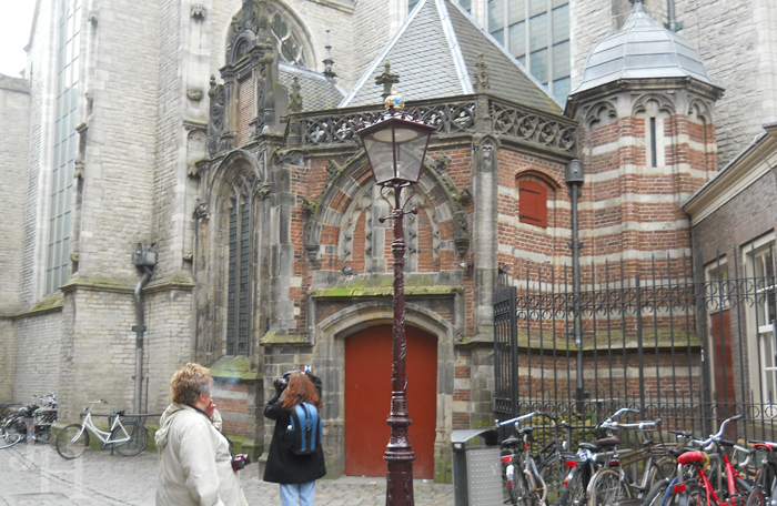 Taking pictures of Oude Kerk in Amsterdam