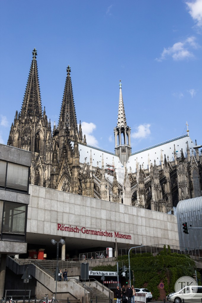 Cologne Cathedral spires tower over the Roman Germanic Museum and the city