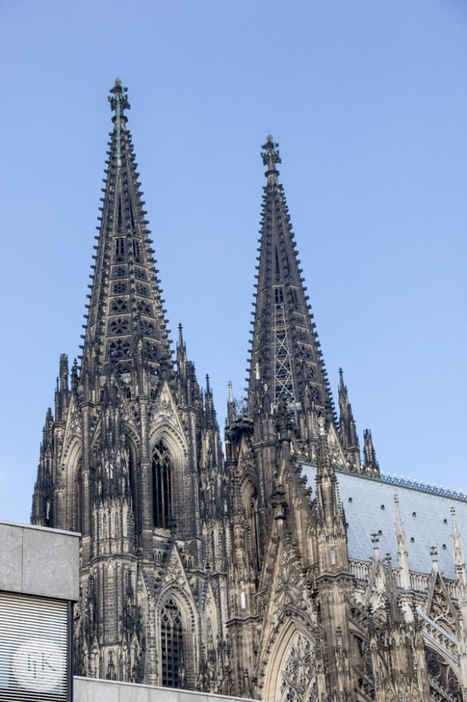 Twin spires peeking out over the roofline of Cologne Cathedral