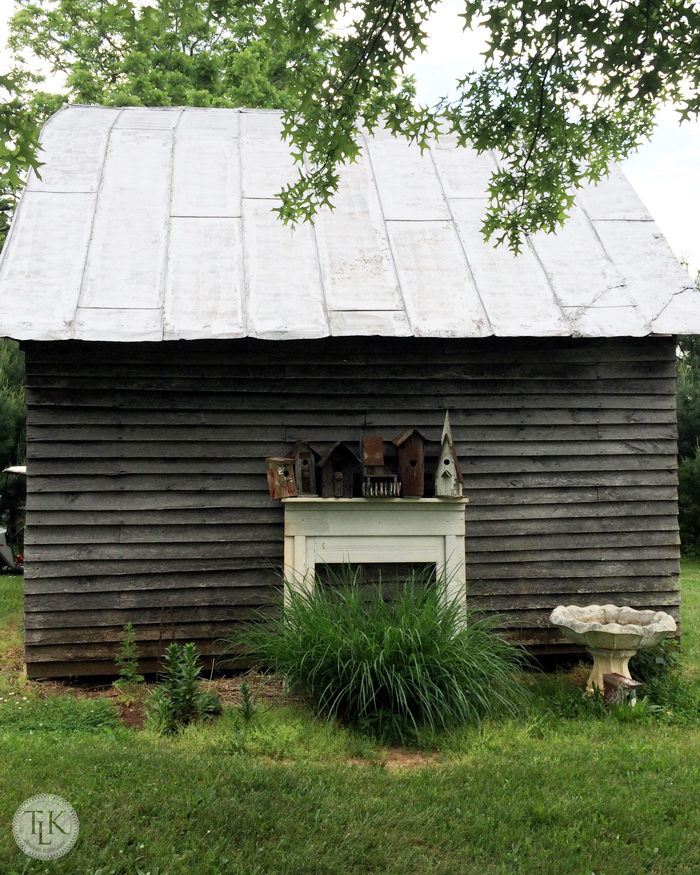 Small barn adorned with a mantel and brdhouses