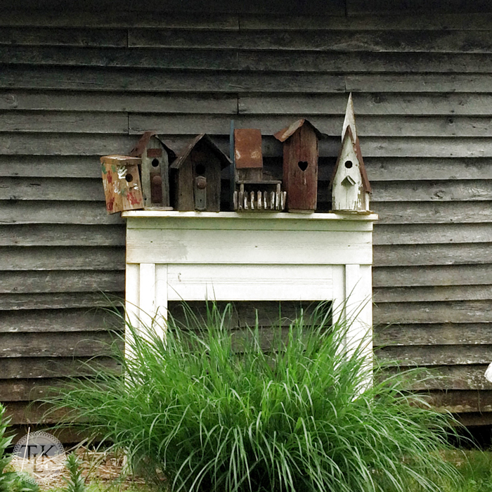 Using a mantel to decorate the outside of an old barn