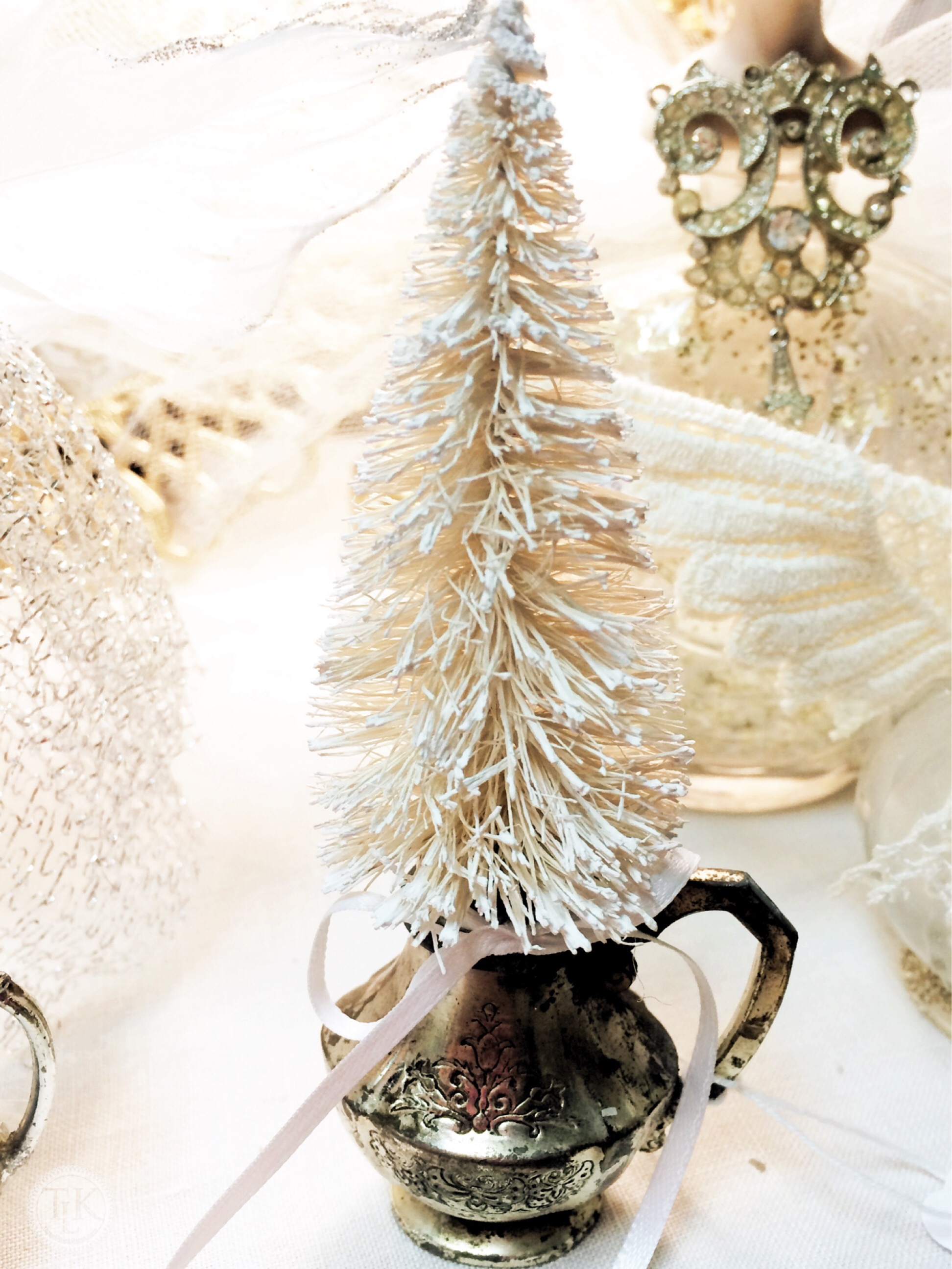 use an old silver plate serving piece as a pot for a bottle brush tree on - Silver Plated Christmas Tree Decorations