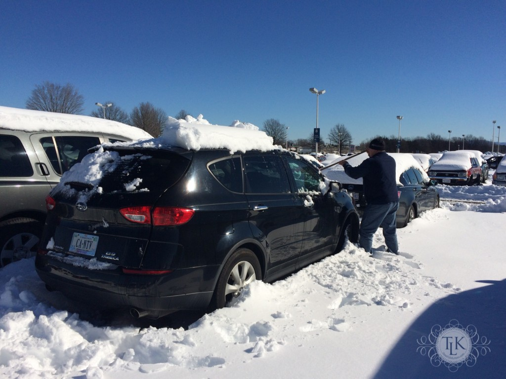 Keith digging out our car at the airport after winter storm Jonas
